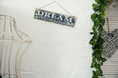 Background of a white wall in the room with a sign to dream Royalty Free Stock Photo