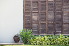 Background White Wall With Latticed Wooden Doors In The Tropical House Stock Image