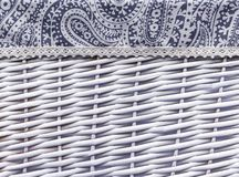 Background from a white wicker basket with fabric decoration stock images