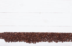 Background white wooden plank with coffee beans Royalty Free Stock Image
