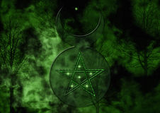 Background with Wiccan God Symbol. Green Forest with the Wiccan God Symbol and Pentacle Royalty Free Stock Photo