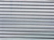Background. Wide shot of silver corrugated metal with bolts Royalty Free Stock Photography