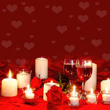 Background with Wine and Candles. Square background image with romantic Candles, two glasses of wine all against red silk and red roses Royalty Free Stock Photography