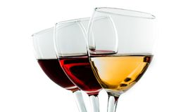 Three glasses of wine - white, rose and red stock images