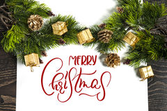 Background for winter holidays greeting card with text Merry Christmas. Calligraphy and lettering.  Stock Photography