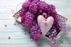 Background With Fresh Splendid Lilac Flowers On Tray And Decor Royalty Free Stock Image