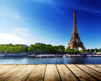 Background With Wooden Deck Table And Eiffel Tower Stock Photo