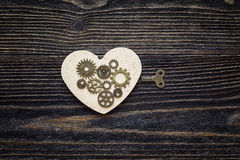 Background withs hape of hearts, the gear mechanism and a key on Stock Images