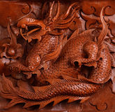 Background wood carving of a dragon Royalty Free Stock Photography