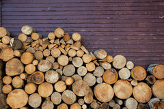 Background of wood logs and old wall Royalty Free Stock Photos