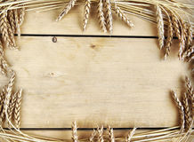 Background with wooden boards and wheat ears Royalty Free Stock Photo