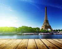 Background with wooden deck table and Eiffel tower. In Paris stock images