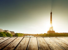 Background with wooden deck table and  Eiffel tower Royalty Free Stock Image