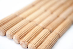 Background of wooden dowels Stock Images