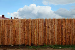 Background wooden fence. On a blue sky royalty free stock images