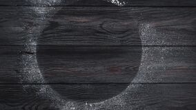 Background. Wooden gray boards sprinkled with flour with an empty circle inside. Top view. Camera movement from right to left.4k. Video stock video