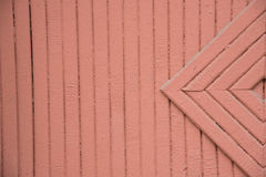 Background of wooden painted in brown or red color strips. Detai. Background of wooden painted in brown or red color strips and rhombus. Detail of a wooden gate Stock Images