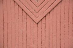 Background of wooden painted in brown or red color strips. Detai. Background of wooden painted in brown or red color strips and rhombus. Detail of a wooden gate Royalty Free Stock Photos