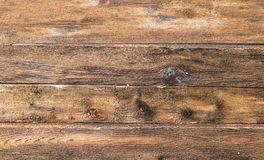 Background wooden planks stacked horizontally beige weathered texture. With natural patterns Stock Image