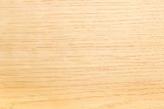 Background of the light-colored oak plank closeup. Background of a wooden surface made of the light-colored oak plank closeup Royalty Free Stock Image