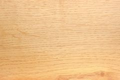 Background of the light-colored oak plank. Background of a wooden surface made of the light-colored oak plank with small knot Stock Photo