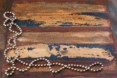 Background wooden table with christmas chaplet Royalty Free Stock Images