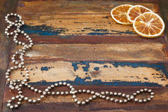 Background wooden table with christmas chaplet and pieces of dri Stock Photos