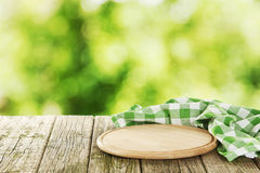 Background with wooden table with the cutting board Royalty Free Stock Images