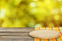 Background with wooden table with the cutting board Royalty Free Stock Photography