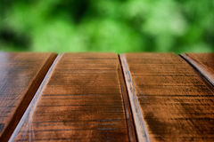 Background of wooden table and green yard Stock Photography