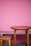 Background with wooden table and grunge pink wall Royalty Free Stock Image