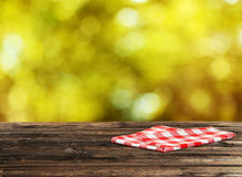 Background with wooden table with a napkin Royalty Free Stock Image