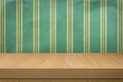 Background with wooden table and old wallpaper  stripes Royalty Free Stock Images