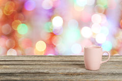 Background with wooden table with the pink cup Stock Photos