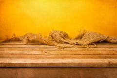 Background with wooden table and sackcloth Stock Photo