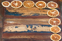 Background wooden table with  slices of dried orange Stock Images