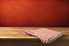 Background with wooden table and tablecloth Royalty Free Stock Photo
