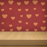 Background with wooden table and wallpaper with heart shape Stock Photography