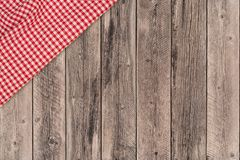 Background with wooden tabletop and checked tablecloth. Top view stock photography