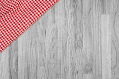 Background with wooden tabletop and checked tablecloth. Top view stock photo