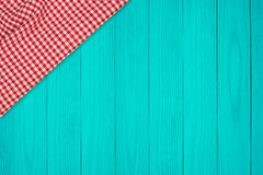 Background with wooden tabletop and checked tablecloth. Top view stock photos