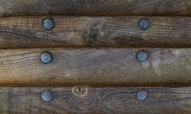Background wooden texture board rivet horizontal board with a row of metal. Rivets Royalty Free Stock Image