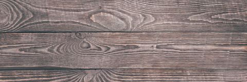 Background of wooden texture boards with remnants of pink paint. Horizontal. Narrow. stock photos