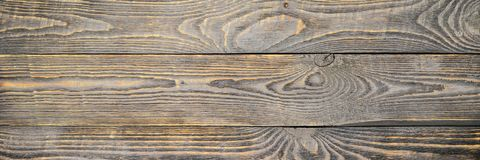 Background of wooden texture boards with yellow color remnants of gray paint. Horizontal. stock photos
