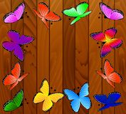 Background with wooden texture and butterflies Royalty Free Stock Photography