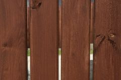 Background of wooden texture, fence of wooden boards. Vertical stripes royalty free stock image