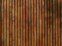 Background - wooden texture from palisades, advertising surface, reddish stock photos