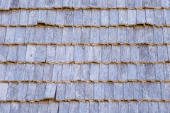 Background wooden tiles close-up. Of the old of the rural house Stock Photography