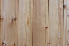 Background, wooden vertical light boards. Wall villas Royalty Free Stock Photography