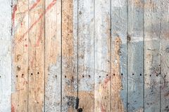 Background of a wooden weathered painted deck surface. Wooden weathered, painted surface of an old deck texture stock photos